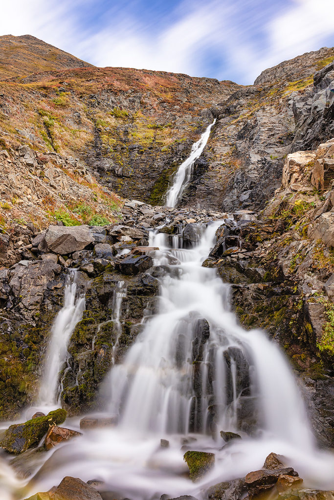 Vertical photo of waterfall in Hope, Alaska.
